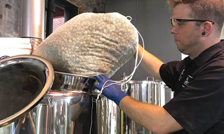Black Cloister brewer adds a bag of fresh hops to kettle
