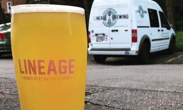 Lineage Brewing's Van Dad in pint glass with delivery van in background.